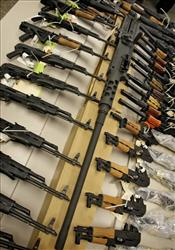 A cache of seized weapons is displayed Tuesday, Jan 25, 2011 in Phoenix. A