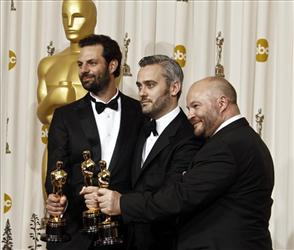 Emile Sherman, left to right, Iain Canning and Gareth Unwin pose backstage with the Oscar for best motion picture for The King's Speech.