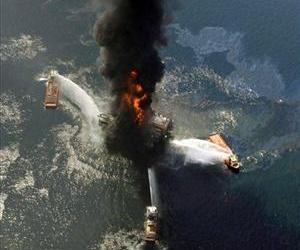 This April 21, 2010 file photo shows the Deepwater Horizon oil rig burning after an explosion in the Gulf of Mexico, off the southeast tip of Louisiana.