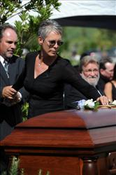 Actress Jamie Lee Curtis places a flower on the casket of her father Hollywood legend Tony Curtis at the Palm Mortuary and Cemetery, Green Valley in Las Vegas on October 4, 2010.