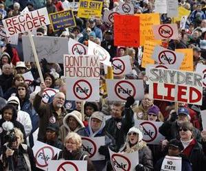 Protestors rally against Gov. Rick Snyder'sbudget, March 15, 2011, outside the Michigan Capitol in Lansing, Mich.