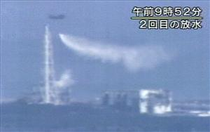 A Japan Self-Defense Force helicopter dumps water over the No. 3 unit of the Fukushima Dai-ichi nuclear power in a desperate bid to prevent a meltdown.