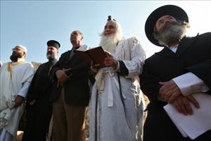 An Muslim imam, a Christian priest,and two Jewish rabbis join a prayer calling for rain in the West Bank village of Walajeh near Bethlehem.