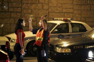 A City of Miami Beach police officer conducts a field sobriety test at a DUI traffic checkpoint.