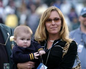 John Daly's wife, Sherri, and son, John Jr., in happier times at the Buick Invitational, February 15, 2004.