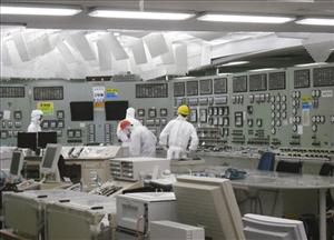 Workers are seen in the control room of the Unit 2 reactor at the stricken Fukushima Dai-ichi nuclear power plant.