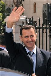 Syrian President Bashar Assad, waves to his supporters after he made his speech at the Parliament, in Damascus, Syria, Wednesday, March 30, 2011.