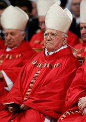Puerto Rico's Cardinal Luis Aponte Martinez attends a mass celebrated by Brazilian Cardinal Eugenio Sales de Araujo in St Peter's Basilica at Vatican12 April 2005.