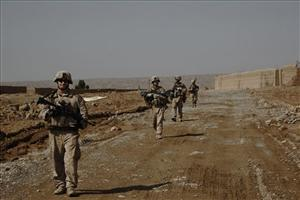 In this image made on Feb. 22, Marines patrol the main road in the Wishtan area of Afghanistan.