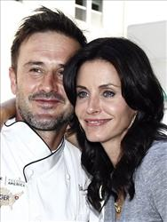 In this Aug. 31, 2009 file photo, David Arquette, left, and Courteney Cox Arquette pose together in Culver City, Calif.