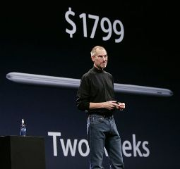 Apple CEO Steve Jobs talks about the price and availability of the new MacBook Air during his keynote at the MacWorld Conference in San Francisco, Tuesday, Jan. 15, 2008.  The super-slim new laptop is less than an inch thick and turns on the moment it's opened. (AP Photo/Paul Sakuma)