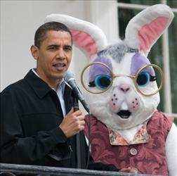 Barack Obama speaks as the Easter Bunny looks on during the annual White House Easter Egg Roll on the South Lawn of the White House in Washington, DC, on April 13, 2009.
