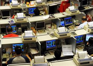 Traders work at the Stock Exchange in Hong Kong.
