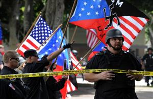 Members of the neo-Nazi group in which Hall was a regional leader taunt counter-demonstrators outside Los Angeles City hall at a protest earlier this year.