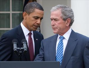 President Barack Obama switches places at the podium with former President George W. Bush after speaking about relief efforts following the earthquake in Haiti at the White House on January 16, 2010.