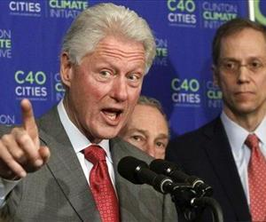 Michael Bloomberg and New York Health Commissioner Dr. Thomas Farley, right, listen as Bill Clinton speaks during a news conference in this April 13 file photo.