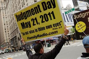 Participants in a movement that is proselytizing that the world will end this May 21, Judgment Day, walk through the streets of New York City.