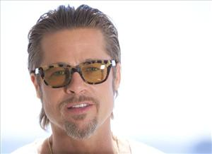 In this photo taken Tuesday, May 17, 2011, actor Brad Pitt poses for portraits promoting the film The Tree of Life at the 64th international film festival, in Cannes, France.