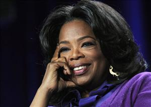 In this Jan. 6, 2011 file photo, Oprah Winfrey listens to a reporter's question during the Discovery Communications Television Critics Association winter media tour in Pasadena, Calif.