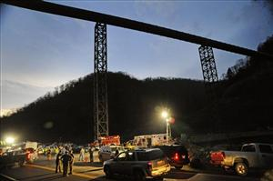 In an April 5, 2010 file photo, West Virginia State Police direct traffic at the entrance to Massey Energy's Upper Big Branch Coal Mine in Montcoal, W.Va.