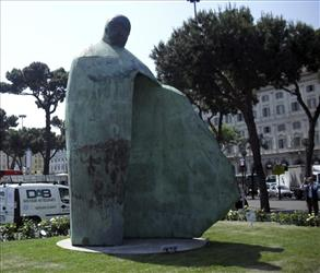 A giant bronze sculpture portraying Pope John Paul II is displayed outside Rome's Termini train Station, Friday, May 20, 2011.