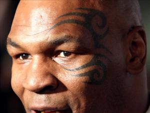 Mike Tyson sports his tattoo. He makes another cameo in the 'Hangover' sequel.