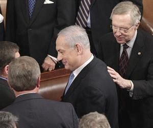 Israel's Prime Minister Benjamin Netanyahu, followed by Harry Reid, right, leaves the House Chamber on Capitol Hill, Tuesday, May 24, 2011, following his address to a joint meeting of Congress.