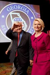 Newt Gingrich  and wife, Calista, wave at the audience gathered to hear him speak in Macon, Georgia.