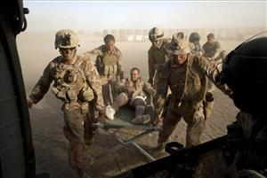 Marines carry a wounded comrade to a medical helicopter in the volatile Helmand Province of southern Afghanistan on May 15.
