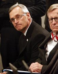 In a March 8, 2011 file photo, Ohio State football coach Jim Tressel, left, sits next to E. Gordon Gee, Ohio State University president, during a news conference.