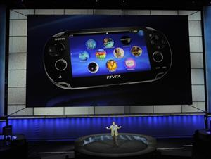 Kazuo Hirai, bottom, President of Sony Computer Entertainment America, introduces the next gaming machine, Playstation Vita, during the E3 Gaming Convention in Los Angeles, Monday, June 6, 2011.