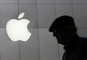 A pedestrian walks by an Apple Store following an announcement that Apple has become the world's most valuable brand on May 9, 2011 in San Francisco, California.