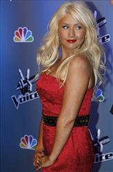 In this March 15, 2011 file photo, singer Christina Aguilera poses at the set of The Voice, series at Los Angeles Center Studios.