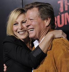 Tatum O'Neal, left, a cast member in The Runaways, poses with her father, actor Ryan O'Neal, at the premiere of the film in Los Angeles, Thursday, March 11, 2010.