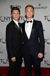 Neil Patrick Harris, right, and his companion David Burtka arrive at the 65th Tony Awards June 12 in New York.