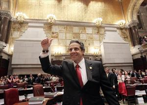 New York Gov. Andrew Cuomo gives a thumbs-up after the vote.
