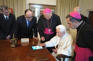 Pope Benedict XVI touches a touchpad to send a tweet for the launch of the Vatican news information portal www.news.va, at the Vatican Tuesday, June 28, 2011.