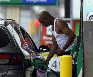 In this May 27, 2011 photo, a customer fuels up his car in view of gas prices, in Philadelphia.