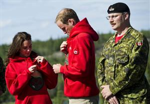Prince William, center, and his wife Kate, adjust their Canadian ranger sweaters as they take part in northern activities at a Blatchford Lake, North West Territories, lodge on Tuesday, July 5, 2011.