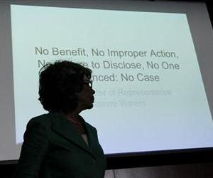 Rep. Maxine Waters, D-Calif., is silhouetted as she presents a PowerPoint presentation during her news conference with reporters in this file photo.
