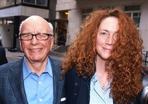 Chairman of News Corporation Rupert Murdoch, left, and Chief executive of News International Rebekah Brooks as they leave his residence in central London, July 10, 2011.