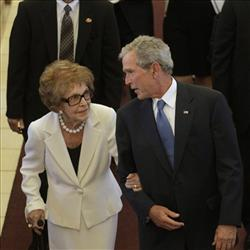 Nancy Reagan is escorted by George W. Bush.