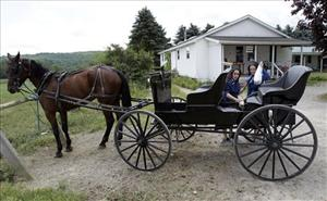 In this July 13, 2011 photo, Amish women shop at an Amish-owned country store in Centerville, N.Y.