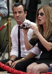 Justin Theroux, boyfriend of Jennifer Aniston, looks on during a ceremony July 7, 2011 where Aniston placed her hand and footprints into cement outside Grauman's Chinese Theatre in Los Angeles.