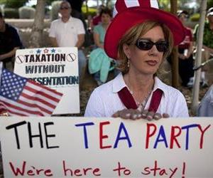 Diana Orrock of Las Vegas listens to speakers during a tea party rally to support Nevada Governor Brian Sandoval's promise not to raise taxes in this April 15 file photo.