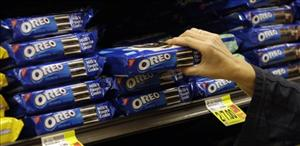 In this Feb. 9, 2011 file photo, a shopper selects Oreo cookies by Nabisco - part of the Kraft Foods Inc. family of brands and products, are seen at a Ralphs Fresh Fare supermarket in Los Angeles.