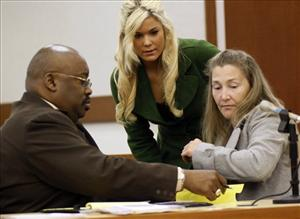 In this Aug. 19, 2009 file photo, Levi Johnston's mother Sherry Johnston, and sister Mercede Johnston, center, speak to attorney Rex Butler in a Palmer, Alaska court.