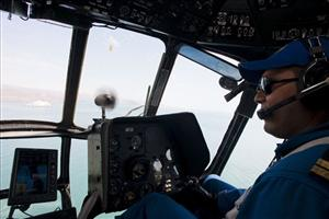 A Mexican Navy helicopter pilot continues the search and rescue efforts for survivors of a fishing boat accident near San Felipe, Mexico, Tuesday July 5, 2011.