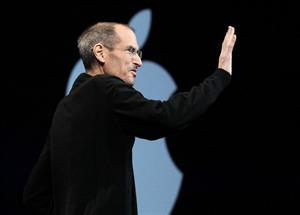 Apple CEO Steve Jobs waves as he delivers the keynote address at the 2011 Apple World Wide Developers Conference on June 6, 2011 in San Francisco, California.