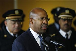 Mayor Michael Nutter, center, flanked by Philadelphia Police Commissioner Charles Ramsey, left.